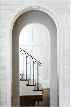 Arched doorways, marble, railing, wainscoting