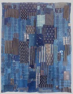Indigo boro. / Made from indigo patches dating from the 19th century. / Fait de morceaux indigo datant du 19e siècle. / Futon cover. / Japan, Japon. / Couverture de futon. / At Esther Fitzgerald shop.