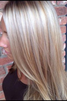 Platinum blonde hair with lowlights.