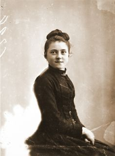 St. Therese, age 14. She was to have an audience with Pope Leo XIII to ask him to permit her to enter Carmel. She put her hair up to look older! She actually grabbed the Pope about his knees and had to be dragged away....so much for her shrinking violet image!