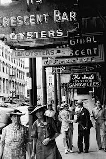 Vintage picture of people strolling in the New Orleans French Quarter