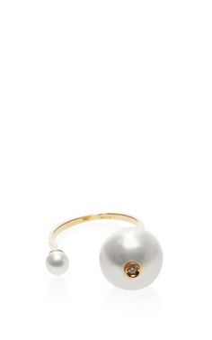 18K Gold and Double Pearl Ring by Delfina Delettrez $940. 18K-gold open ring, featuring dueling pearls in opposing sizes and a sparkling diamond inset. 18K gold/pearl/0.015 ct. diamond Made in Italy