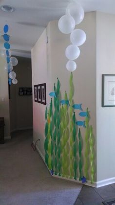 The Little Mermaid Ariel Under the Sea Party: Decorations - streamer seaweed, paper fish, balloon bubbles  By the bathroom??