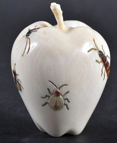 Shibyama inlaid ivory fruit netsuke, decorated with insects. 2.25ins high. 19th century, Japan