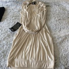 Bebe light gold dress Bebe drape front sparkle dress. Size XXs brand new with tags but part if tag is starting to come off. Excellent condition. Form fitting. Functional pockets; bebe Dresses Mini