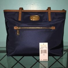 """Michael Kors nylon tote This is brand new with tags (not attached) size is 14"""" across the top and 10"""" down, navy blue with brown leather. Perfect condition! MICHAEL Michael Kors Bags Totes"""