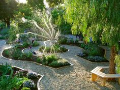 Parterre-Style---Intricate gravel paths edged in brick wind through this garden, which evokes classic parterre designs. Fragrant flowers, herbs and vegetables provide moments of discovery along the way.