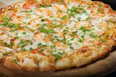Lobsters, Shrimp and Scallops combine to create a sublime pizza eating experience!