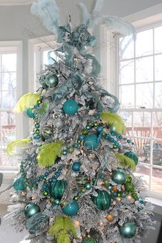 blue and lime for a fun edgy twist cover your tree with bright blue and lime green decorations the feathers are optional of course but are a great - Tiffany Blue Christmas Decorations