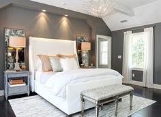 Love this room - the tall headboard, mirrors behind the lamps and bench.  And the wall color - Amherst Gray by Benjamin Moore.
