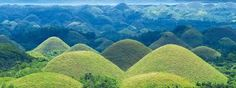 The Chocolate Hills is a famous tourist attraction of Bohol. They are featured in the provincial flag and seal to symbolize the abundance of natural attractions in the province. They are in the Philippine Tourism Authority's list of tourist destinations in the Philippines;they have been declared the country's third National Geological Monument and proposed for inclusion in the UNESCO World Heritage List.