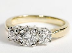 Three Stone Diamond Ring in 18k Yellow Gold. Similar to what my engagment ring looks like, but the side diamonds are black