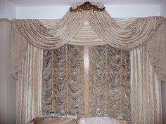 Elegant arched swags, jabots, framing panels and Austrian Shades all custom made by THE FABRIC MILL