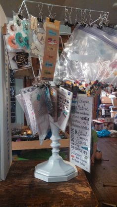 DIY Clip-it-up - Scrapbook.com- An old lamp frame turned into a hanging storage system for embellishments