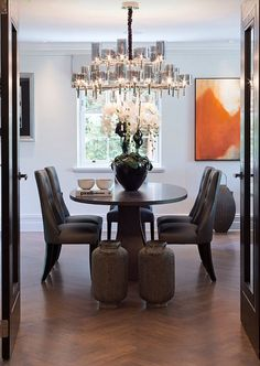 Lovely dining room with just the right splash of colour from that gorgeous piece of art