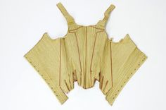 Stays, Spain (?), 18th century. Pale yellow silk, pink silk ribbon, leather, boned and lined with linen.