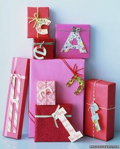 Attach letters to gifts.  use paperboard from cereal boxes to make them sturdy, then add paper or fabric on top