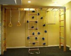 Indoor rock walls and kids gym idea. For basement, rock climbing on end instead of ladder and horisontal ladder inbetween floor joists. Swings to attach or take down.