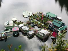 """They live completely off grid for 20 years in this vibrant self-sustaining floating home. Like a scene from Waterworld, this couple have this beautiful """"floating fortress"""" to call home. Located on the coast of Vancouver Island, British Columbia. Floating Island, Floating House, Island 2, Small Island, Island Life, Self Sustaining, Floating Platform, Destinations, Off The Grid"""