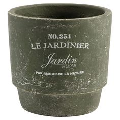 Display vibrant blossoms or lush greenery in this charming ceramic pot, showcasing a French script motif and a weathered finish.   P...