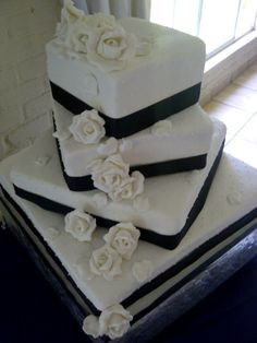 A gorgeous black and white wedding cake with rose details - Belle's Patisserie