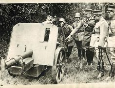 1929- General Diaz, Inspector-General of the Chilean army, being shown German field pieces during a tour of inspection of a German military camp near Berlin.
