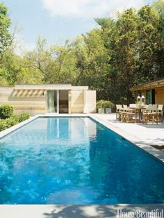 A guest room opens out to the pool in a Hamptons house designed by Form Architecture + Interiors.