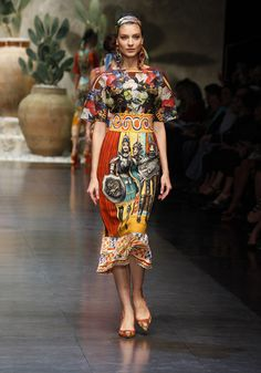 Dolce & Gabbana Women Fashion Show Gallery – Spring Summer 2013 Collection - The photos of Dolce & Gabbana Woman Fashion Show Spring Summer 2013 inspired by the most profound Sicilian Tradition:prints with the puppets of Sicilian street theaters, typical local barrows and the Caltagirone head-shaped ceramic vases and dishes. #idemtiko es @Kenny Chang Milano