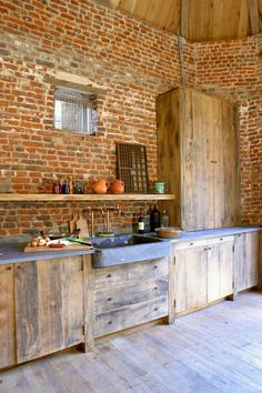 Who says a kitchen has to be cold and clinical? With elements of rough wood, stone, concrete, and brick, these kitchens exude an irresistible rustic warmth. New Kitchen, Rustic Kitchen, Kitchen Remodel, Outdoor Kitchen, Modern Kitchen, Home Kitchens, Kitchen Projects, Kitchen, Kitchen Dining Room