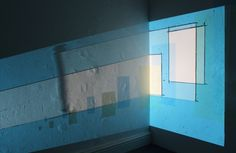"Installation work for 'Rendered Invisible' (2016). Fiona explores the effects of natural light, but this windowless environment prompted a new approach. ""Contemporary drawing in an old fashioned way – using a slide projector, handmade slides and egg tempera wall drawing to create a tension between old and new technology."" #fionagrady #light #wallart #printmaking #geometricart #geometry #line #pattern #colour #prints #onlineprintshop #limitededitionprints #lookup #lookupprints"