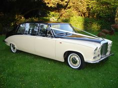 Beautiful Daimler DS420 Limousine cream & black wedding car from www.Classicbridalcars.net of Wirral