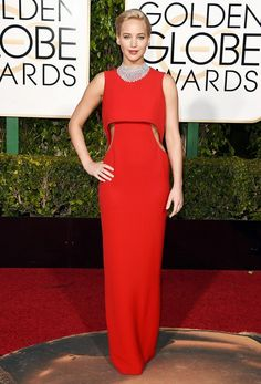 Jennifer Lawrence wears a Dior Haute Couture red silk crepe column gown with cut out detail and a statement-making Chopard necklace.