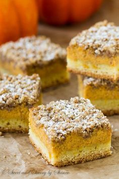 Pumpkin Streusel Bars - 3 incredible layers of cake crust, smooth and creamy pumpkin filling and crumbly. Buttery streusel topping make these pumpkin streusel bars out-of-this-world delicious! Just Desserts, Delicious Desserts, Dessert Recipes, Yummy Food, Best Pumpkin Pie, Pumpkin Recipes, Fall Baking, Holiday Baking, Pumpkin Dessert