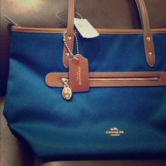 [NWT] COACH sawyer blue - Bright mineral canvas This Tote bag has a unique blue color which they claimed as blue mineral color. It has 1 front pocket and 2 inside pockets. Coach Bags Totes