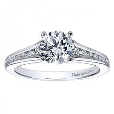 Classic channel set diamond engagement ring available at Emma Parker & Co.