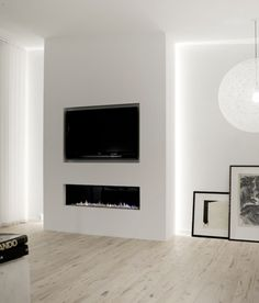 Modern fireplace with inset TV above and great side lighting which could light some shelves, but minimum, or art