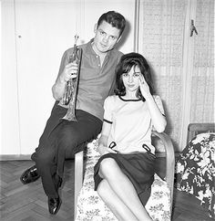 American trumpet player and singer Chet Baker posing with his partner and British dancer Carol Jackson. 1962