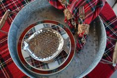 Tartan plates with aluminum fish for a fishing theme Christmas