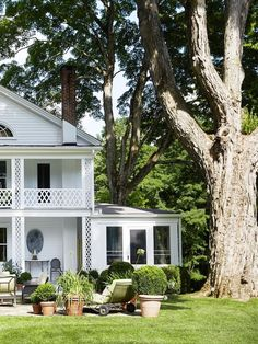 Black shutters on a white clapboard exterior add serious East Coast charm to this stunning Connecticut estate.