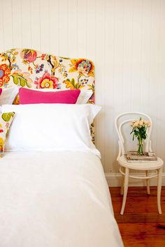 Bedheads - The Fabric Frame. This company is based in Graceville. They have different shapes and can cover in different fabrics. You might be better off to get a plain fabric and change up your cushions rather than being 'stuck' a floral