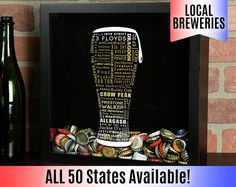 Craft Beer Typography Beer Cap Shadow Box ________________________________________________________________ • Dimensions : 13 x 13 x 3.5 • Holds Up To 500 Bottle Caps • 1.75 diameter top loading hole • Four triangle mounting hooks Our shadow boxes make the perfect gift! Designed by