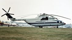 Aeroflot Mi-26 at the 1984 Farnborough Air Show. The first Mi-26 flew on 14 December 1977[4] and the first production aircraft was rolled out on 4 October 1980. Development was completed in 1983, and the Mi-26 was in Soviet military and commercial service by 1985.