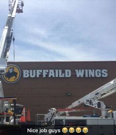 Buffalo Wild Wings sign installation fail.