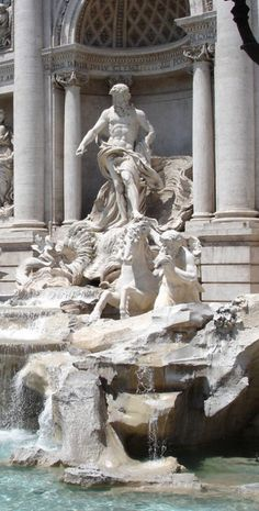 Travelers toss a coin into the Trevi Fountain to ensure they'll return to Rome. Join us there on Day 1 of the Rick Steves Heart of Italy Tour.