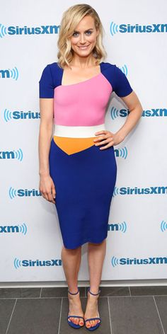 "It takes a brave woman to wear a dress after it's already been seen on Blake Lively (in a Vogue video nonetheless), but the OITNB star is up to the task, rocking this Roland Mouret ""Cassida"" design at SiriusXM in N.Y.C. with coordinating Stuart Weitzman heels."