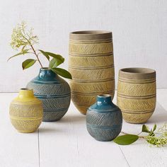 Hand-thrown and crafted of terracotta, the Linework Vases are embellished with intricate etched designs.