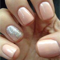nude nails with a sparkly accent