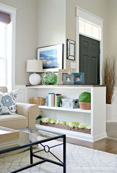 Ideas to separate an open entryway or front door from the living room using buil. Ideas to separate an open entryway or front door from the living room using built ins, a bookcase or budget friendly ideas. Photo via Thrifty Decor Chick Living Room Kitchen, Living Room Decor, Living Room Without Entryway, Living Room Entrance Ideas, Bookcase In Living Room, Half Wall Kitchen, Front Room Decor, Decor Room, Kitchen Shelves