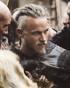 THE VIKINGS Ragnar Played by Travis Fimmel...... Anyone else think he and Charlie Hunnam should play brothers in a movie?