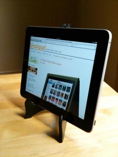 Probably one of the simplest ipad stands I've seen. Picture frame easel.